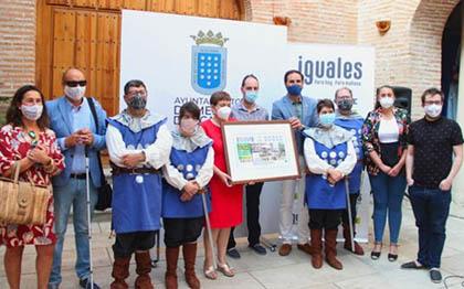 Foto de familia de todos los participantes en la presentación del cupón
