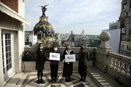 Foto de familia de la presentación de los cupones dedicados al Día de la Igualdad Salarial y al Día Internacional de las Mujeres